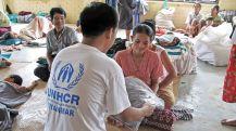 young-cyclone-nargis-victim-myanmar-receiving-blanket-unhcr-worker